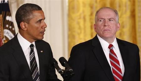 White House counterterrorism advisor John Brennan (R) listens as U.S. President Barack Obama nominates him to become the next CIA director at the White House in Washington.  (REUTERS/Kevin Lamarque)