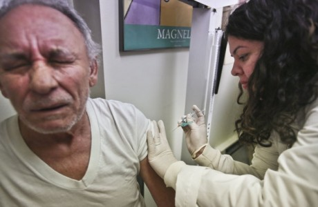 Carlos Maisonet, 73, reacts as Dr. Eva Berrios-Colon, a professor at Touro College of Pharmacy, injects him with flu vaccine during a visit to the faculty practice center at Brooklyn Hospital in New York. Health officials said Thursday, Feb. 21, 2013 this season's flu shot was only 9 percent effective in protecting seniors against the most common and dangerous flu bug. Flu vaccine tends to protect younger people better than older ones and is never 100 percent effective. But experts say the preliminary results are disappointing and highlight the need for a better vaccine. (AP Photo/Bebeto Matthews, File)