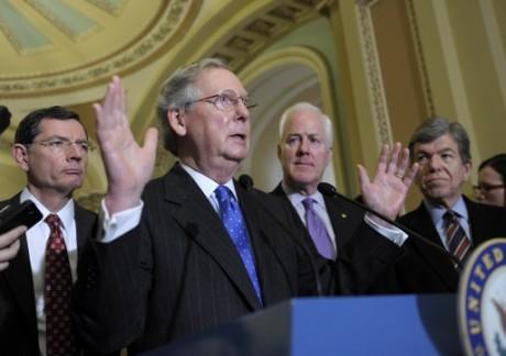 Senate Minority Leader Mitch McConnell of Ky., second from left, gestures as he speaks during a news conference on Capitol Hill in Washington, Tuesday, March 12, 2013. He is joined by, from left, Sen. John Barrasso, R-Wyo., Senate Minority Whip John Cornyn of Texas, and Sen. Roy Blunt, R-Mo.  (AP Photo/Susan Walsh)