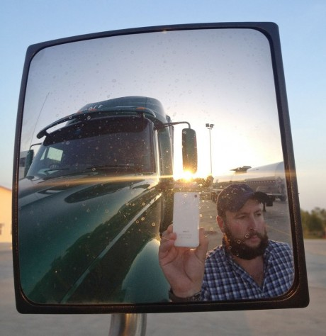 "James Weitze takes a self portrait on the road. Weitze satisfies his video fix with an iPhone. He sleeps most of the time in his truck, and has no apartment. To be sure, he's an extreme case and probably wouldn't fit into Nielsen's definition of a household in the first place. But he's watching Netflix enough to keep up on shows like ""Weeds,"" ""30 Rock,"" ""Arrested Development,"" ""Breaking Bad,"" ""It's Always Sunny in Philadelphia"" and ""Sons of Anarchy."" (AP Photo/James Weitze)"