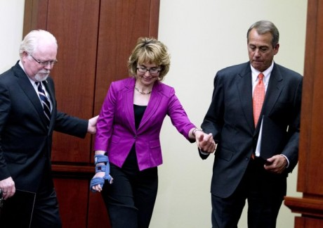 Former Rep. Gabrielle Giffords, D-Ariz., walks with Rep. Ron Barber D-Ariz., and Speaker of the House John Boehner of Ohio, during the dedication of a room in the Capitol Visitors Center to slain congressional staffer Gabriel Zimmerman on Capitol Hill, in Washington, Tuesday, April 16, 2013. Zimmerman died two years ago in the Tucson, Ariz., attack that critically wounded Giffords and took six lives. (AP Photo/Jose Luis Magana)