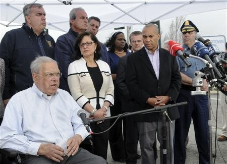 Boston Mayor Tom Menino speaks from his wheelchair during a news conference, as Massachusetts Governor Deval Patrick and public safety officials watch, in Watertown, Massachusetts April 19, 2013. REUTERS/Neal Hamberg