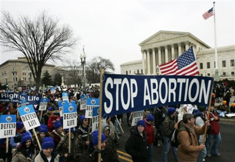 Anti-abortion marchers walk near the Supreme Court during the annual March for Life, Tuesday, Jan. 22, 2008, in Washington. The rally comes 35 years after the Supreme Court ruled that a Texas woman with the pseudonym Jane Roe had a constitutional right to have an abortion. (AP Photo/Haraz N. Ghanbari)