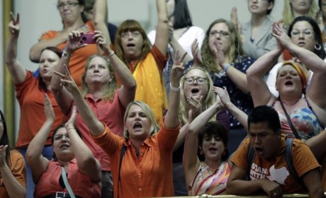 Members of the gallery cheer and chant as the Texas Senate tries to bring an abortion bill to a vote as time expires, Wednesday, June 26, 2013, in Austin, Texas. Amid the deafening roar of abortion rights supporters, Texas Republicans huddled around the Senate podium to pass new abortion restrictions, but whether the vote was cast before or after midnight is in dispute. If signed into law, the measures would close almost every abortion clinic in Texas. (AP Photo/Eric Gay)