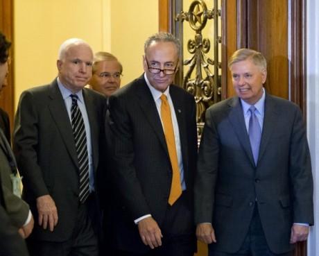 Senators John McCain, Chuck Schumer and Lindsey Graham after immigration bill clears Senate (AP/J.Scott Applewhite)