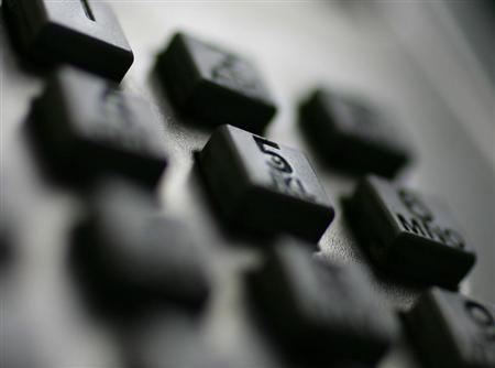 A keypad is seen on a public phone. (REUTERS/Tim Wimborne)