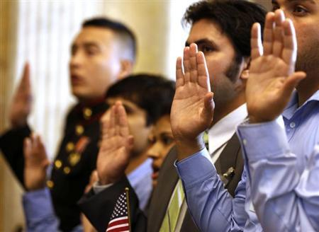 Candidates swear in as United States citizens during a Special Naturalization Ceremony for 30 U.S. citizen candidates in the Cash Room at the U.S. Treasury Department in Washington, July 3, 2013. ( Reuters/Larry Downing)