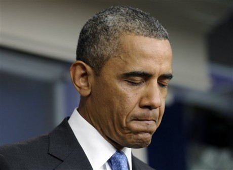 President Barack Obama pauses as he speaks about the death of Trevyon Martin at the beginning of the daily White House briefing in the Briefing Room of the White House in Washington, Friday, July 19, 2013. (AP Photo/Susan Walsh)