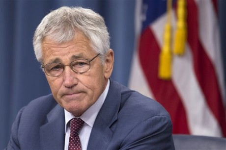 Defense Secretary Chuck Hagel pauses during a news conference at the Pentagon, Wednesday, July 31, 2013. Hagel is warned that the Pentagon may have to mothball up to three Navy aircraft carriers and order more sharp reductions in the size of the Army and Marine Corps if Congress does not act to avoid massive budget cuts beginning in 2014.  (AP Photo/Evan Vucci)
