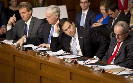 Republican Senators Jeff Flake, Ron Johnson, Marco Rubio and James Risch.  Now what? (Reuters/Joshua Roberts)