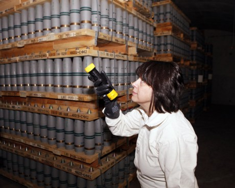Debra Michaels, Chemical Operations Manager uses a flashlight to inspect mustard agent shells in one of the bunkers at the Pueblo Army Chemical Storage facility in Pueblo, Colo. (AP Photo/Ed Andrieski)