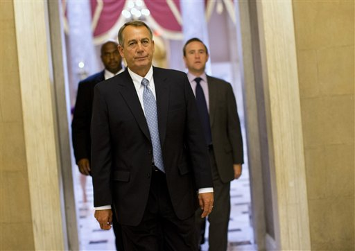 House Speaker John Boehner of Ohio walks to his office on Capitol Hill in Washington. (AP Photo/ Evan Vucci)