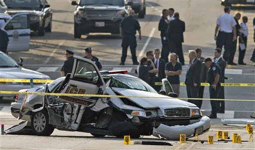 A damaged Capitol Hill police car is surrounded by crime scene tape after a car chase and shooting on Capitol Hill in Washington, Thursday.  (AP Photo/ Evan Vucci)