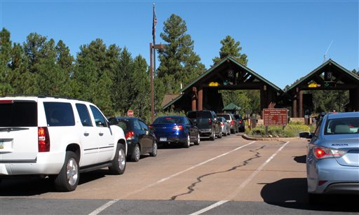 Cars line up at Grand Canyon National Park's South Rim entrance on Tuesday.  (AP Photo/Felicia Fonseca)