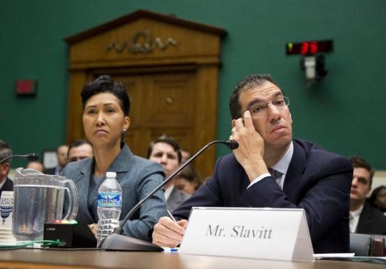 Cheryl Campbell of CGI and Andy Slavitt, QSSI, answer questions at hearing. (AP/Evan Vucci)