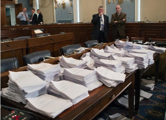 Just part of the paperwork that confronts Congress for work on the 213 Farm Bill. (AP/J. Scott Applewhite)