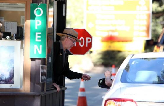 Yosemite Park Ranger Ron Morton takes payment for admittance after park reopened. (AP/Gary Kazanjian)