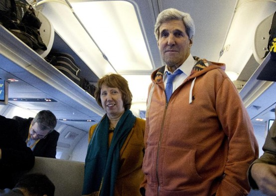 Secretary of State John Kerry and EU foreign policy chief Catherin Ashton face press on Kerry's plane. (AP/Carolyn Kaster)