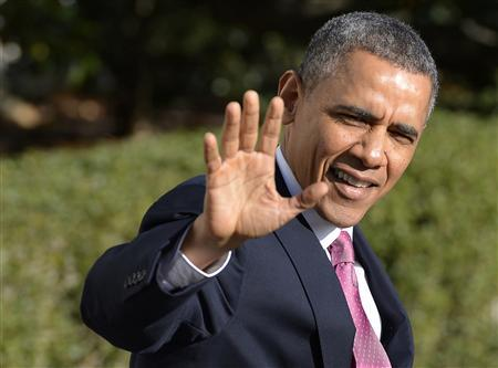 U.S. President Barack Obama waves to the press as he departs the White House Sunday.. (REUTERS/Mike Theiler)