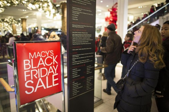 A shopper tries to figure out where she wants to go at Macys at Herald Square in New York. (AP/John Minchillo)