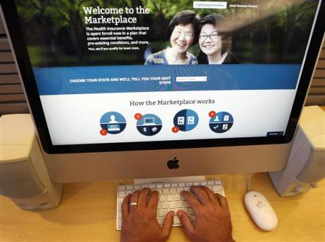A man looks over the Affordable Care Act (commonly known as Obamacare) signup page on the HealthCare.gov website in New York in this photo illustration. (REUTERS/Mike Segar)