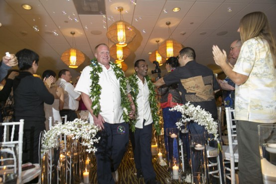 Shaun Campbell and partner Tony Sigh tie the know in Honolulu. (AP/Marco Garcia)