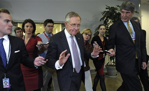Senate Majority Leader Harry Reid pursued by reporters on Capitol Hill in Washington, Wednesday.  (AP Photo/Susan Walsh)