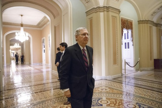 enate Minority Leader Mitch McConnell, R-Ky., walks to the chamber for the final votes on the bipartisan budget deal. (AP Photo/J. Scott Applewhite)