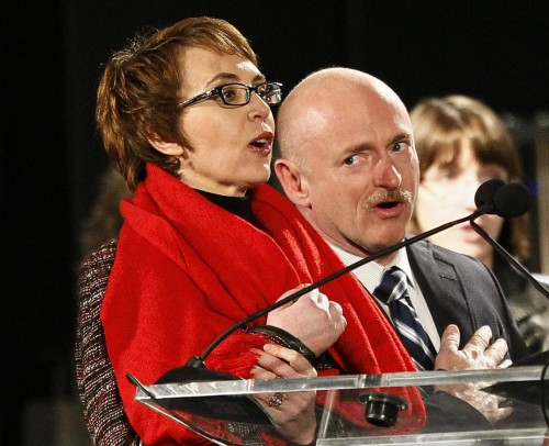 Gabrielle Giffords leads pledge of allegiance with her husband, former astronaut Mark Kelly (AP/Matt York)
