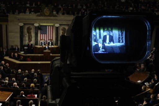 President Barack Obama is seen through a television camera viewfinder as gives his the State of the Union address on Capitol Hill in Washington.  (AP Photo/Susan Walsh)