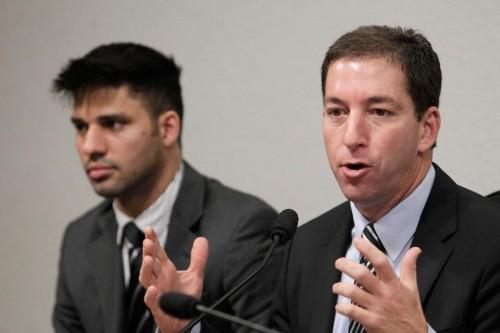 American journalist Glenn Greenwald and partner David Miranda. (AP Photo/Eraldo Peres)