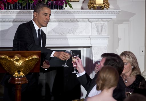 President Barack Obama toasts after delivering remarks during a dinner for the National Governors Association. (AP Photo/ Evan Vucci)