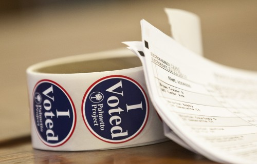 """A roll of """"I Voted"""" stickers rests on a table near a voter registration list at the Old Train Depot in Denmark, South Carolina.  (REUTERS/Chris Keane)"""
