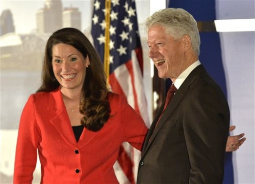 Democratic Senate challenger Alison Lundergan Grimes left, speaks with former Presidet Bill Clinton as they are introduced at a fundraiser at the Galt House Hotel, Tuesday, in Louisville, Ky. (AP Photo/Timothy D. Easley)