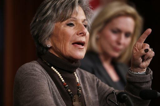 Sen. Barbara Boxer, D-Calif., left, accompanied by Sen. Kirsten Gillibrand, D-N.Y., speaks during a mews conference on Capitol Hill in Washington, Thursday. (AP Photo/Charles Dharapak)