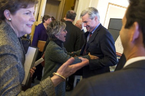 Senate Environment and Public Works Committee Chairman Sen. Barbara Boxer, D-Calif., talks with Sen. Sheldon Whitehouse, D-R.I., during a meeting of the Senate Climate Action Task Force prior to taking to the Senate Floor all night to urge in Washington. (AP Photo/ Evan Vucci)