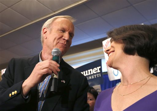 Bruce Rauner, left, thanks his wife Diana as they celebrate Rauner becoming the Republican gubernatorial candidate (AP Photo/Charles Rex Arbogast)
