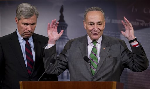 Sen. Charles Schumer, D-N.Y., right, accompanied by Sen. Sheldon Whitehouse, D-R.I., speak to reporters on Capitol Hill.  (AP Photo/Manuel Balce Ceneta)