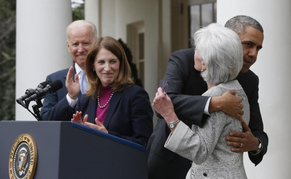 President Barack Obama hugs outgoing Health and Human Services Secretary Kathleen Sebelius as he stands with Vice President Joe Biden and his nominee to be her replacement, Budget Director Sylvia Mathews Burwell, Friday. (AP Photo/Charles Dharapak)