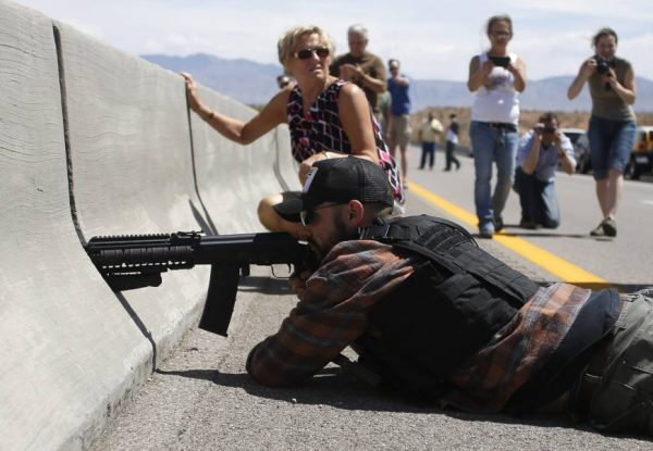 Militia member and protestor Eric Parker takes aim at Bureau of Land Management agents at Nevada standoff. (Reuters)