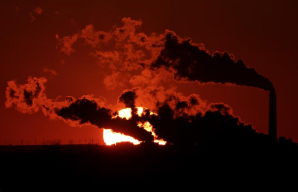 Steam from the Jeffrey Energy Center coal-fired power plant.  (AP Photo/Charlie Riedel, File)