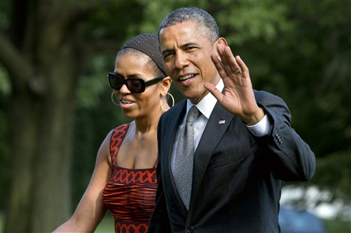 President Barack Obama with first lady Michelle Obama.  (AP Photo/Jacquelyn Martin)