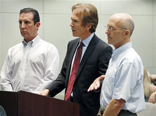 Mark Mayfield, right, a member of the board of the Central Mississippi Tea Party, and attorney John Reeves, left, listen as Mayfield's attorney Merrida Coxwell   (AP Photo/Rogelio V. Solis)