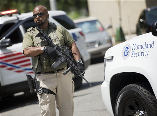 A US Marshal takes his position outside the federal court  (AP Photo/Pablo Martinez Monsivais)