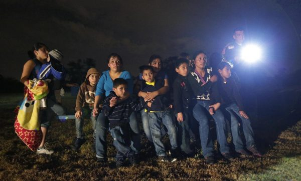 Immigrants from Honduras and El Salvador who crossed the U.S.-Mexico border illegally.  (AP Photo/Eric Gay)