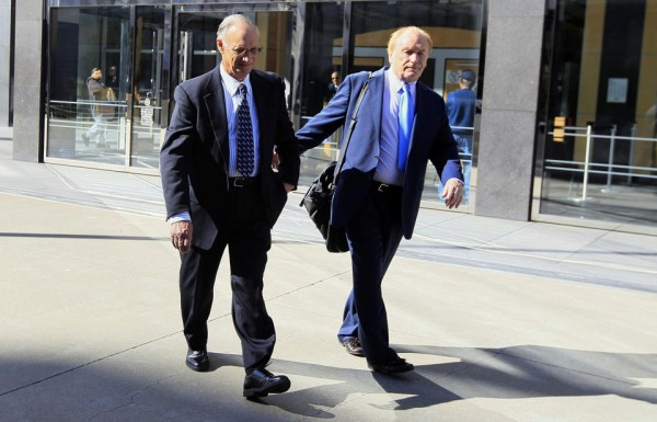 Robert Maegerle, left, walks out of a federal courthouse with attorney Jerome Froelich Jr. in San Francisco.  (AP Photo/Jeff Chiu)