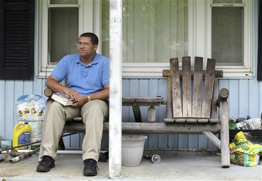 David Vernon, 18, takes a break while reading on his porch in Columbus, Ohio  (AP Photo)