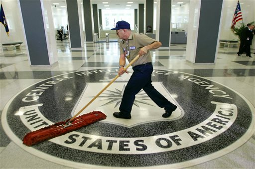 A workman quickly slides a dustmop over the floor at the Central Intelligence Agency headquarters in Langley, Va. (AP Photo/J. Scott Applewhite, File)