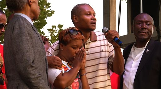 Lesley McSpadden, Michael Brown's mother, second from left, stands next to her cousin, Eric Davis  (AP Photo/Alex Sanz)