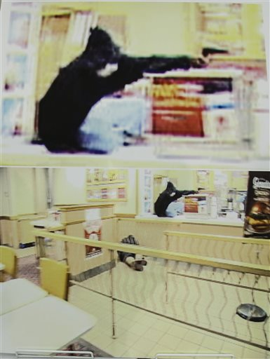 Frame grabs from security video showing an armed robbery at a Wendy's restaurant in Omaha is displayed during a news conference at police headquarters in Omaha, Neb., Wednesday (AP Photo/Nati Harnik)